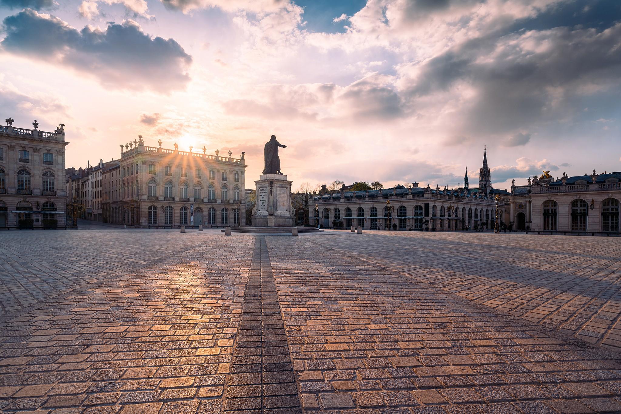 Soleil couchant dans les nuages | Place Stanislas